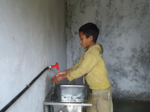 Post Image - Boy using hand basin