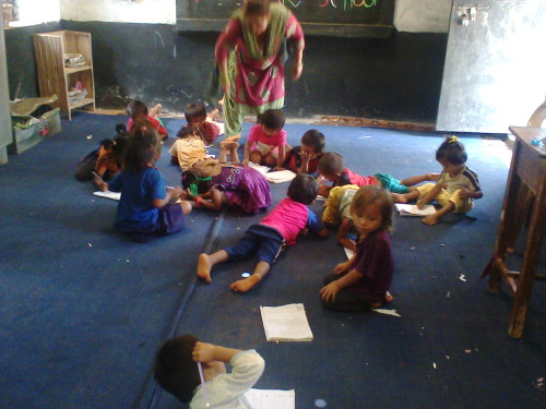 Teacher Kamala in the nursery with the children 2