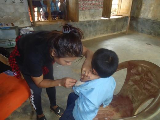 kid taking measles  vaccine
