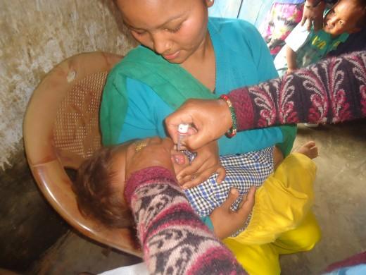 kid taking polio